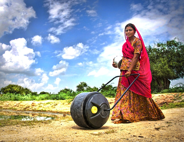 an indian woman using rollable water drum by wello